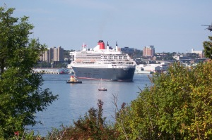 Queen Mary 2 turning to dock at Pier 22.  Theodore Tugboat in foreground.
